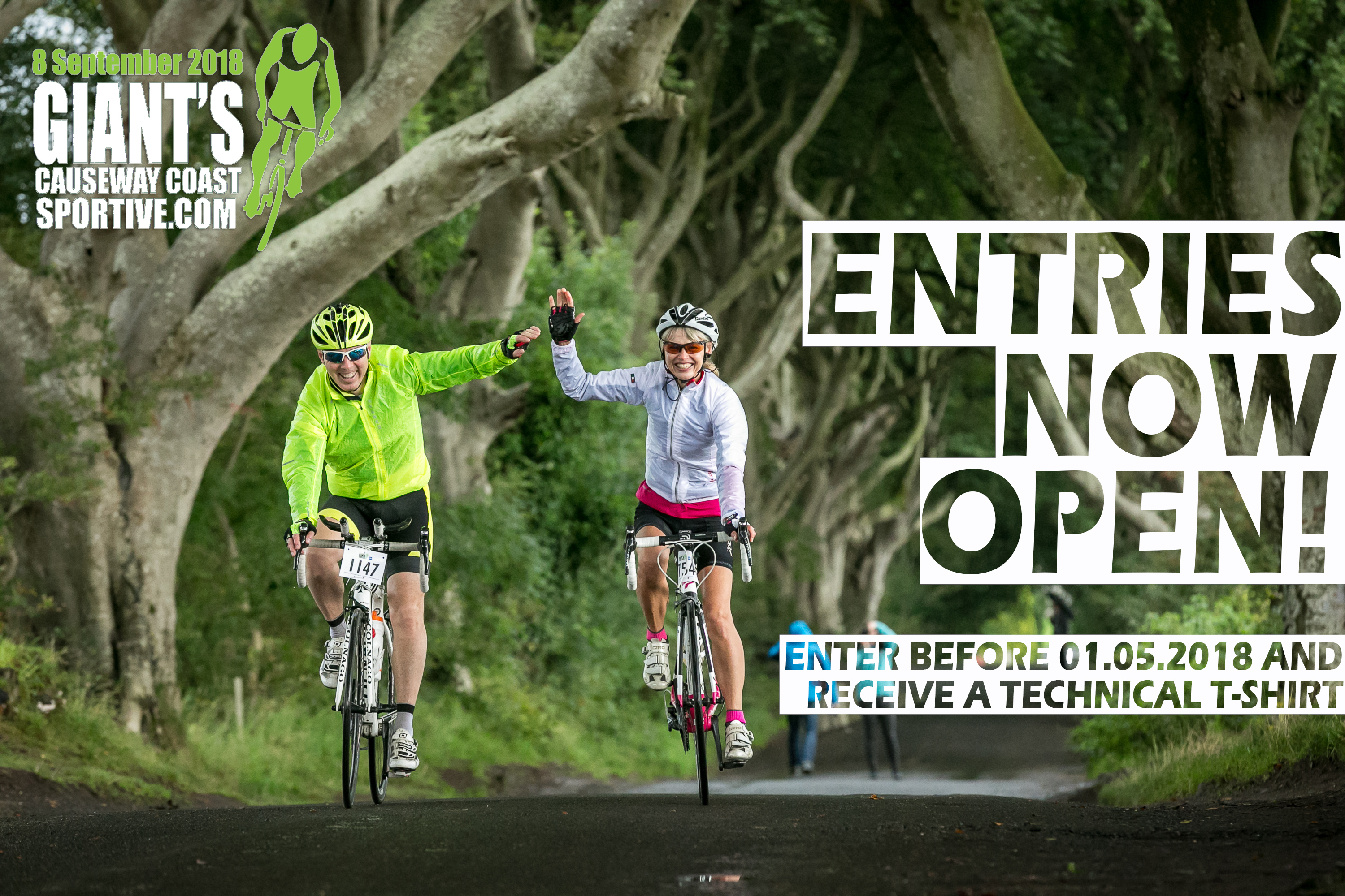 Two riders cycling through the Dark Hedges during the Giant's Causeway Coast Sportive
